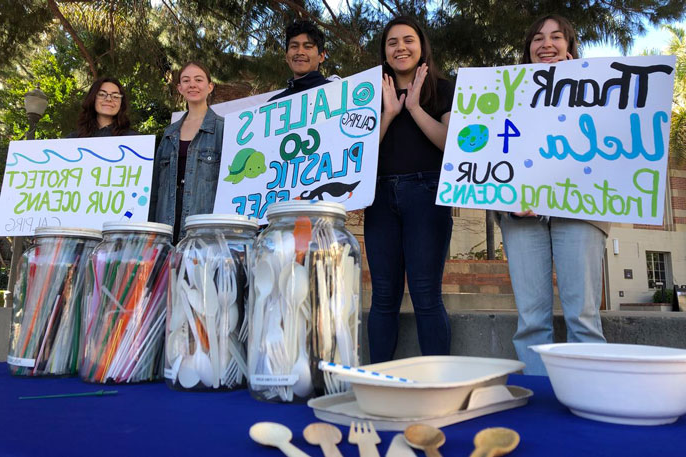 Students from CALPIRG hold up signs thanking UCLA and saying help protect our oceans
