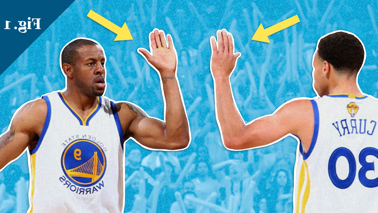 Two basketball players do a high-five