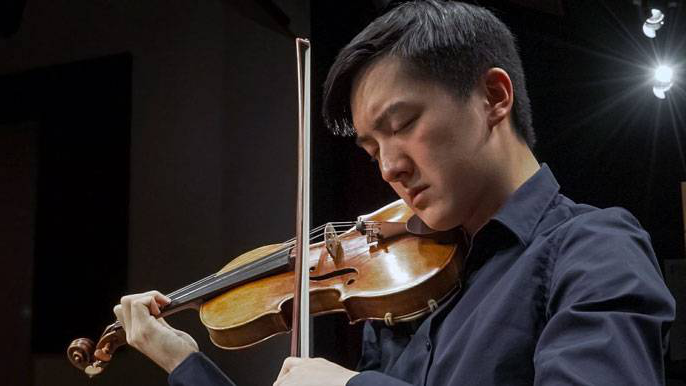 Elvin Hsieh playing the Stradivarius violin that was already owned by UCLA