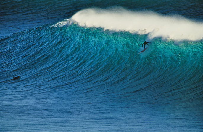 Surfer surfing on a big wave